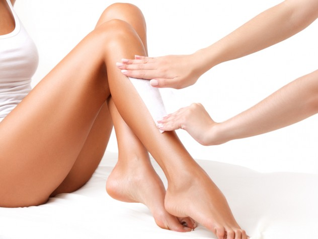 Woman Having Leg Waxing Treatment