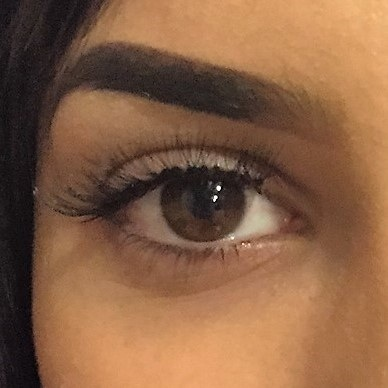 Woman's eye with long cluster eyelashes