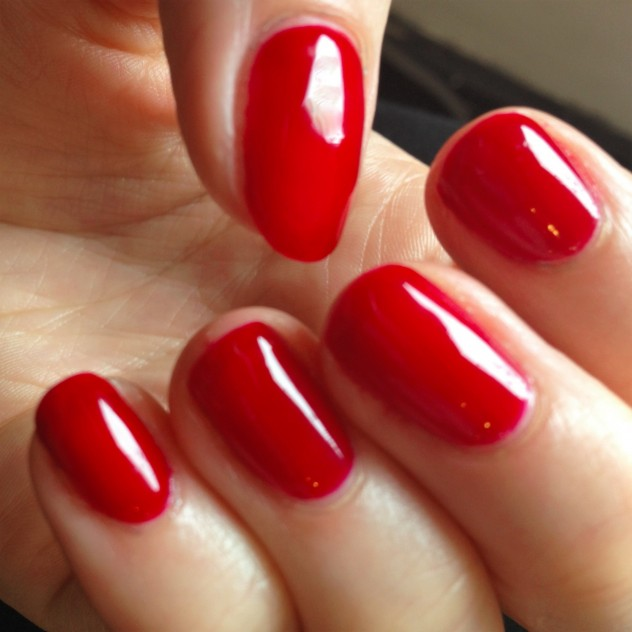 Shiny red Gelish gel nails