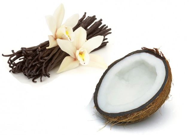 Vanilla bean pods, cream flowers and half a coconut shell
