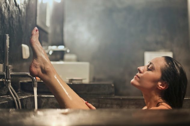 Woman in bath soaking her feet